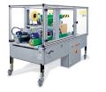 LOGO_Vollautomatische Faltschachtel-Verschließmaschine TAPEMATIC NBF-400 mit oberer Deckelzufaltvorrichtung für gleich bleibende Paketgrößen.
