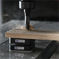 LOGO_Schmalz vacuum clamping systems Innospann for retrofitting efficiently CNC woodworking centres