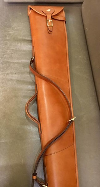 LOGO_Leather flap over gun slip